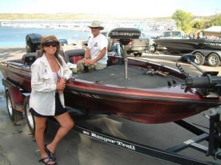 Peggy Harrell and Mark Nesbit and their bass boat at Navajo Lake, New Mexico.