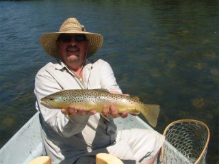 The author, Karl Moffatt, shows off a nice Brown trout caught in the lower San Juan River during a July 2010 trip.