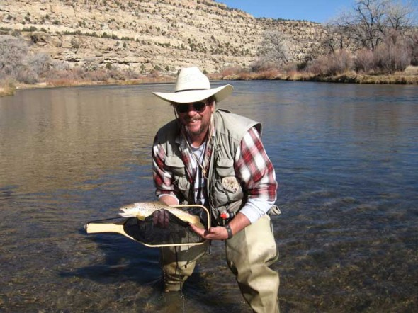 Author Karl F. Moffatt with a nice Brown Trout caught at Simon Canyon on the San Juan River in November 2008. Special thanks to David McGee of Roswell for taking the photo.