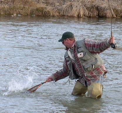 The author nets a trout while winter fishing on the San Juan River at Simon Canyon in 2005.