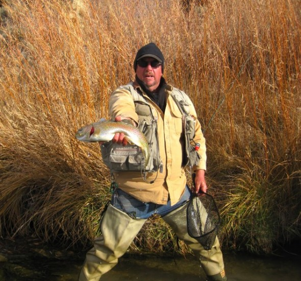 The author shows off a typical San Juan River Rainbow trout.