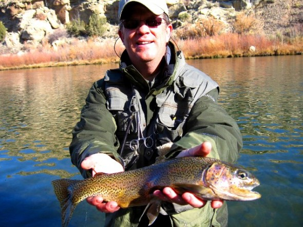 Man shows off fat trout at San Juan River