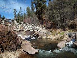 A bridge over the Jemez River leads to Spence Hot Springs.