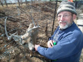 Founder and Executive Director, Roger Alink, visits with Lucky the Deer at Wildlife West Nature Park in Edgewood, New Mexico.