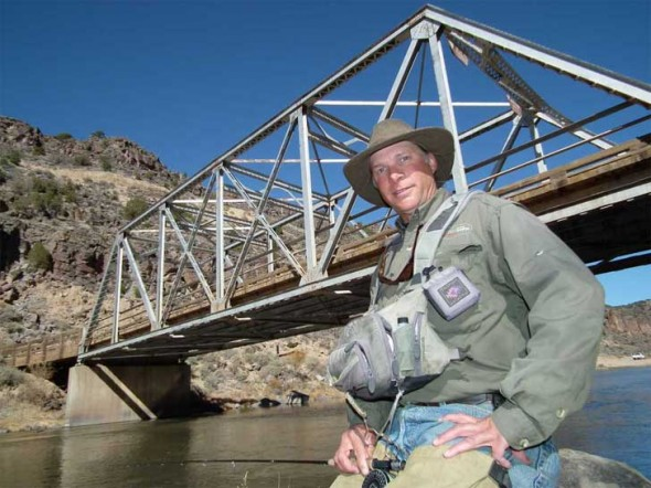 Fishing guide, Van Beacham of Taos, poses by the John Dunn Bridge on the Rio Grande.