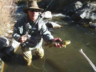 Beacham shows off a Brown trout caught in the Arroyo Hondo near Taos.