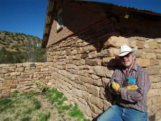 Bob Dolson leans on the goat barn he converted into his studio at his home in the tiny village of Villanueva on the Pecos River between Santa Fe and Las Vegas, New Mexico.