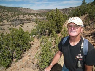 Pat Lambert, a railroad retiree from of Sheridan, Wyoming, enjoys an early spring hike up the overlook trail at Villanueva State park in New Mexico.