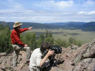 National Park Service Cinematographer, John Grabowska, directs a shot of the Valles Caldera during filming for Bandelier.