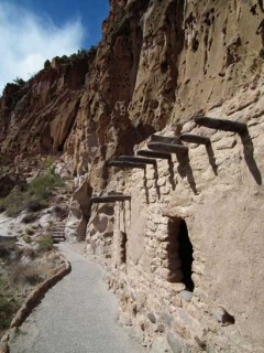 A reconstructed adobe and viga cliff dwelling at Bandelier National Monument in New Mexico.