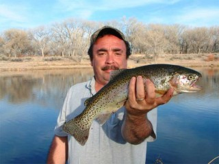Vigil of Pojoaque shows off a nice trout caught at San Ildefonso pueblo.
