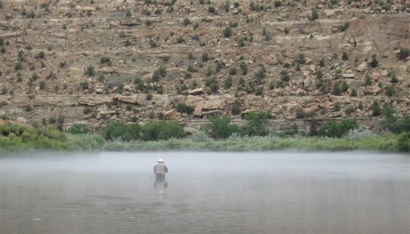 An angler in the mist on the San Juan River in northwestern New Mexico.