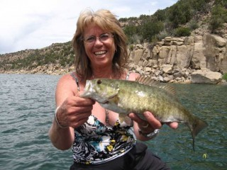 Peggy Harrell shows off a nice Smallmouth Bass from Navajo Lake.