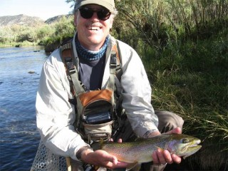 Angler Thom Cole of Santa Fe shows off a typical San Juan River Trout.
