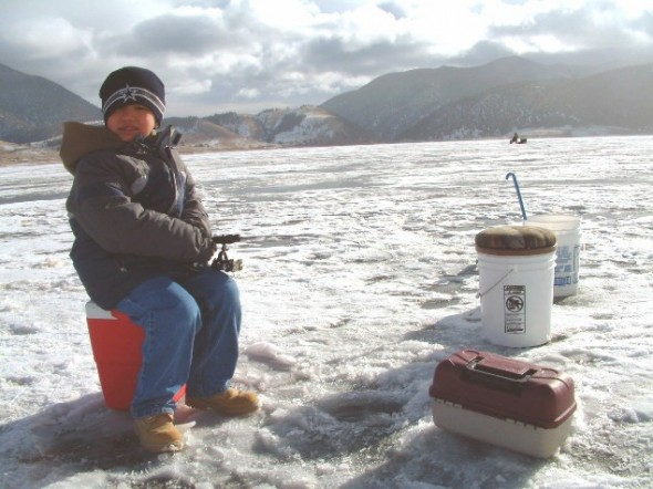 Adam Vigil, 7, of Taos waits patiently for a bite while ice fishing with his family at Eagle Nest Lake on Saturday, Jan.5, 2008.