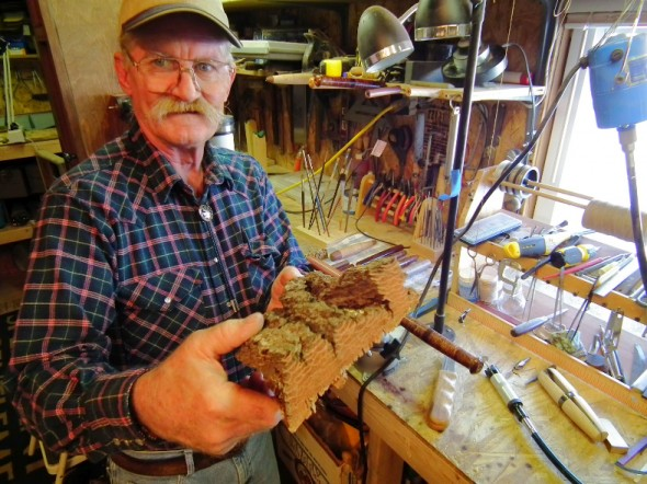 Bruce Smith shows off the kind of wood that can be used to create  a custom rod handle.