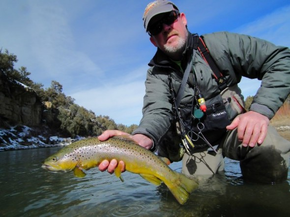 Toner Mitchell poses with brown trout caught in the Chama River of  northern New Mexico.