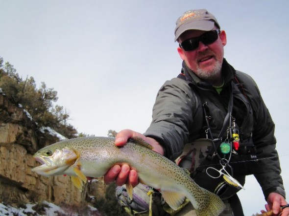 An angler shows off a fat rainbow trout caught while winter fishing on the Rio Chama in northern New Mexico.