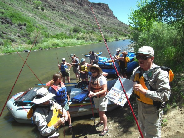 "Renowned author of ""Fishing in New Mexico"" Ti Piper who has been teaching kids and adults how to fish for the New Mexico Department of Game and Fish (NMDGF) for years provides instruction on lures to Project Wild Participants during an outing to the Rio Grande in June, 2012."