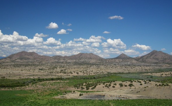 The view east from Galisteo Dam shows the backside of nearby Cerrillos Hills State Park.