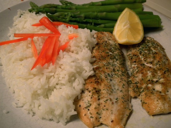 Broiled, seasoned  salmon, steamed white rice and asparagus make for a great meal.