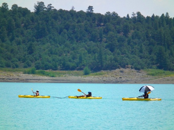 kayakers paddling across Heron Lake