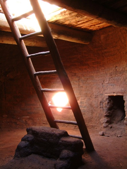 Ladder leading down into an underground kiva.