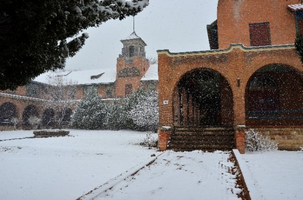 A spring snow storm leaves a dusting on  the Castenada Hotel in Las Vegas NM.