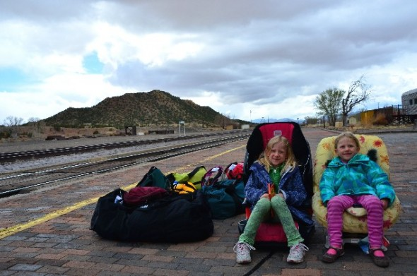 Kids in car seats wait fro train at Lamy NM