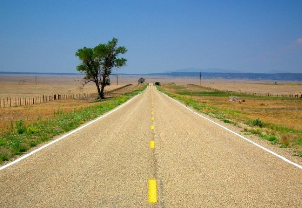 A long lonely stretch of two lane black top on the plains of eastern New Mexico.