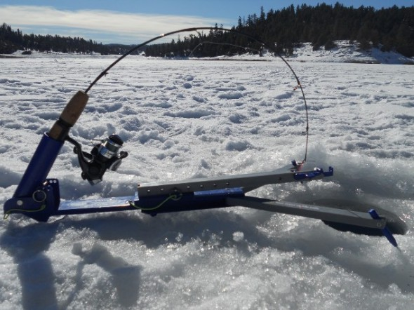 The hands free Jawjacker ice fishing device set up over a ice fishing hole on a lake somewhere in New Mexico.