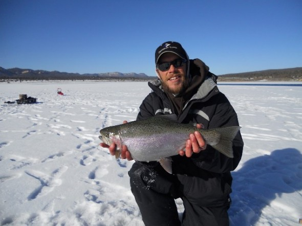Matt Pelletier of Fish Enchantment shows off a nice trout caught while ice fishing in New Mexico.