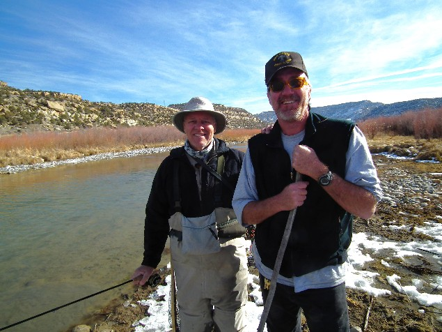 Angler Mike Lee of Arizona and Marc Wethington, Fisheries Biologist on the San Juan River for the New Mexico Department of Game and Fish, pose or a photo on the Lower Flats in Dec. 2013.