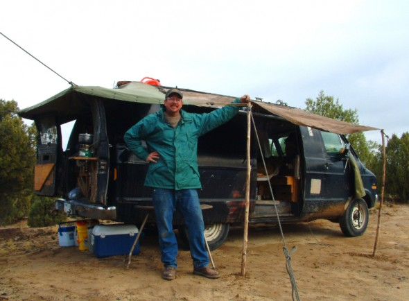 Man poses by camping van