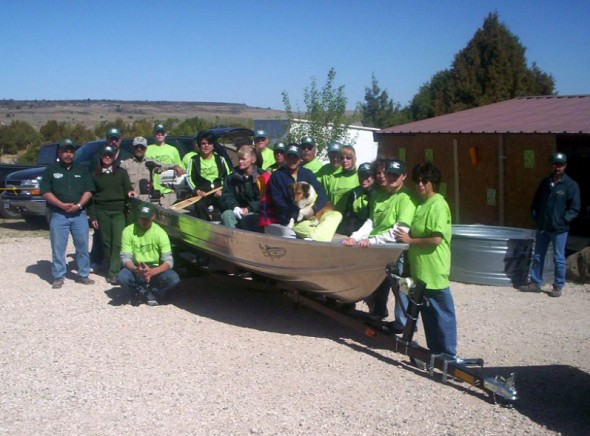 Group photo with boat at Clayton Lake State Park NM