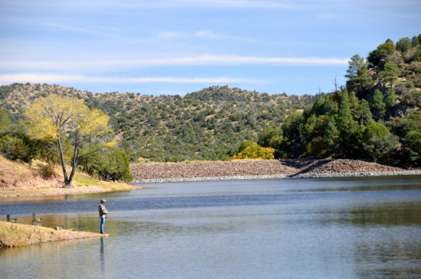 Man fishing at Bear Canyon reservoir in New Mexico